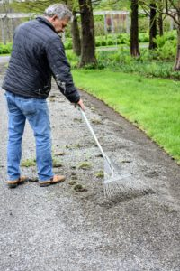 After a section is complete, Fernando uses a soft rake to remove all the debris from the road. This is also a good time to check for any weeds that have grown and pick them up.