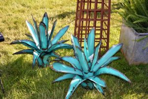 Trade Secrets is also a nice source for unusual outdoor antiques such as these metal blue agaves from Marvin Gardens. http://marvingardensusa.com/