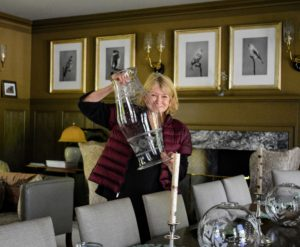 Inside, I was busy preparing for dinner in my Brown Room. Here I am removing the big antique hurricanes from the long dining table - they are beautiful, but a bit too tall for comfortable table conversation.