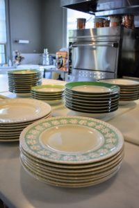 When setting up for a party, I always choose the dinner plates and serving platters early, so I am sure I have enough for all the guests and all the dishes being served. It's okay to use dinner plates from different sets if you're expecting a large group - use coordinating colors and your table will look great.