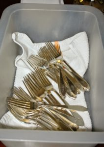 I also pulled out the silverware and placed them on a towel in a small bin to carry them to the dining table for setting - so much easier than carrying by hand.