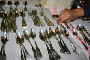 I have thousands of silver spoons, forks, and knives - many purchased from antiques fairs and shops over the years. I love using them whenever I entertain, so polishing three or four times a year is generally sufficient to keep everything in good condition.