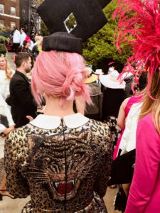 This guest's hat complemented her dress decorated with a tiger on the back.