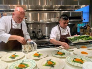 Pierre and sous chef Kevin Cutuc plate the asparagus and carrot puree at the large counter in my Winter House kitchen.