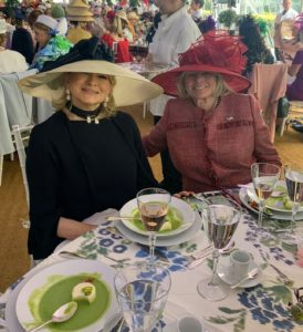 "It's my good friend and banker, Jane Heller, who accompanies me to the ""hat luncheon"" every year. All the tables were set in pretty floral patterns – perfect for spring. Provided by Scalamandre, the tablecloths were also available for sale with proceeds going to the Central Park Conservancy."
