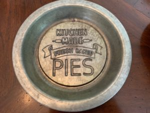 Here is one of the old pie tins - I love the saying at the bottom.