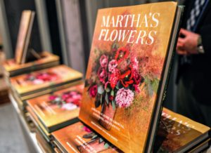 "There were stacks of ""Martha's Flowers"" on display for guests to purchase for signing - many bought multiple copies. I hope you all have your deluxe edition of my book – it's one you'll love to give as a gift and to keep for yourself. (Photo by Carlos Ledesma for Magrino)"