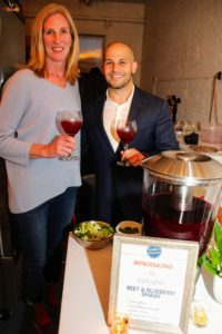 This is Emily Wilson with Stelios Stavrianos, owner of Cylinder Vodka. They are enjoying the evening's signature cocktail - beet and blueberry smash with vodka, elderberry liqueur, berries, beets, and citrus. (Photo provided by Unger Media for Mike's Organic)