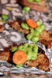 Another appetizer - English peas with pea puree and pickled baby carrots on cracked wheat toast. (Photo provided by Unger Media for Mike's Organic)