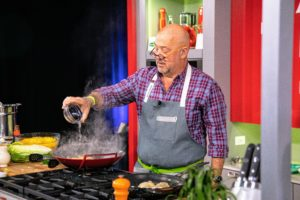 Chef Andrew Zimmern was also doing a demo nearby - he was cooking noodles on a wok - it smelled wonderful. (Photo by Galdones Photography)