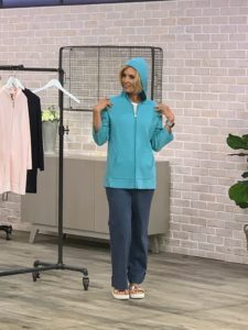 QVC host Kerstin Lindquist is wearing my hoodie in sea blue. This hoodie was inspired by one that I have in cashmere, but as you know, cashmere can't be worn in summer. This is an elegant solution to a cardigan. I love it.