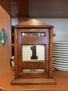 This is an antique calendar that Cheryl and Gretchen update every day - it sits on the table in my kitchen. On the left is a three-minute egg timer I put there last year - it is very accurate.