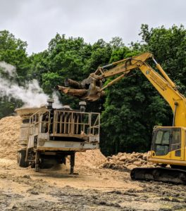 The excavator works with a hydraulic system allowing Dan to raise and lower the long boom and bucket. Because the chassis is built on top of the undercarriage, it is also able to rotate 360-degrees.