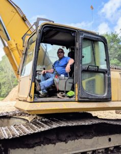 Here's Dan at the controls of the excavator early the next day. Dan has been doing this for many years and works very quickly and efficiently.
