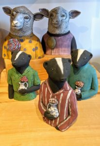 I also admired these whimsical figures - skunks carrying vases of flowers.