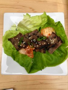 It can be served on a lettuce leaf with Kimchi, gochujang paste, sliced cucumbers and scallions.
