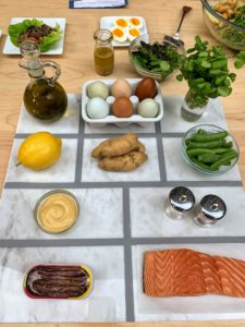The ingredients are all displayed on the table, so everyone can see. These are the ingredients for our Salmon Salad with Sugar Snap Peas, Eggs, and Potatoes.
