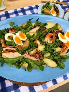 We cooked about one and quarter pounds of skin-on salmon fillet and served it in a salad with potatoes, watercress, eggs, sugar snap peas and our dressing made with anchovies, Dijon mustard, and lemon juice.