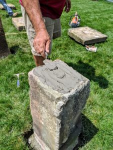 A layer of cement is also placed on the top of the base, where the two pieces will meet.