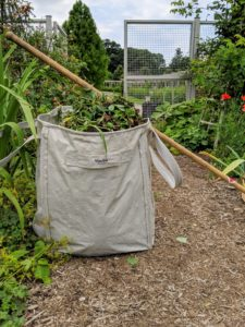 My XL Multi-Purpose Garden Totes from QVC are perfect for gathering all of the deadheaded clippings - everyone on my outdoor grounds crew loves these bags - they're so strong and durable. Each one can hold more than 900-pounds!