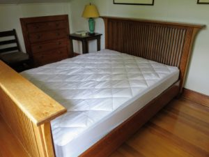 Here is the same bed with the new mattress pad in place - it's a perfect fit.