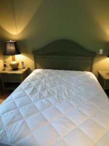 Here is a queen-sized bed over my garage - now with its new mattress pad. And don't forget – it is always recommended to rotate your mattress regularly. Rotating and fluffing will keep it in the best condition.