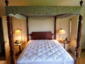 This is one of many beds at Skylands - a queen-sized bed in my main house. A regular queen-sized mattress measures 60-inches by 80-inches. Some antique queen mattresses measure 57-inches by 76-inches. The mattress pad fits just right.