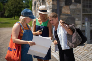 Amanda Favorite, Susanne Ruppert, and Greta Anthony look over the map to plan their strategy. (Photo by Paytn Leigh)