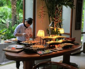 Here is the chef preparing a delicious buffet of foods.