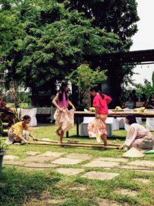 Back outside, children played Tinikling - a traditional Philippine folk dance which originated during the Spanish colonial era. The dance involves two people beating, tapping, and sliding bamboo poles on the ground and against each other in coordination with one or more dancers who step over and in between the poles in a dance.