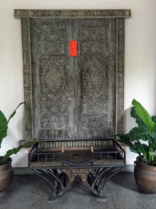 This door hung on the wall had a small piece of red ribbon, which symbolizes welcome, sanctuary and status. Red also invites good luck and happiness during the Chinese New Year.