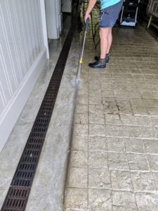Down at my stable, power-washing is in full swing. Here's Helen washing the stone floors in the large main walkway between the horse stalls.