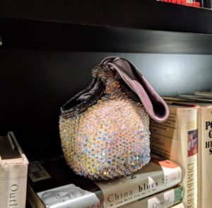 Bea Valdes makes intricate bags with elaborate beading. Several of her bags were displayed on the bookshelf.