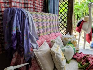 Many textiles were on display. I love the colorful patterns of these bed coverings and pillows. Everything is handmade.