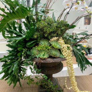 The space was decorated with beautiful tropical arrangements.
