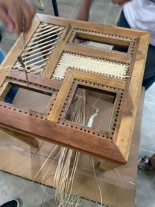 This is rattan being weaved for an armoire door.