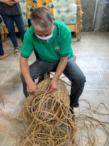 And here is a worker weaving a basket - all done by hand. The workers use masks to protect them from any dust from the rattan.