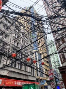"Our next stop was Binondo, a district in Manila referred to as the city's Chinatown - the world's oldest Chinatown established in 1594. The ""spaghetti"" wire connections above the streets was a faster and easier way for telecom businesses to expand in this old area."