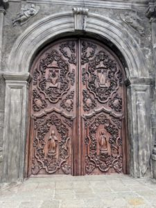 This is the entrance to San Agustin Church in Intramuros - it is the oldest baroque church in the country. It is also the only UNESCO heritage site in Metro Manila. Its rich and intricately carved door bears the relief of St. Augustine, his mother St. Monica, and symbols of the Augustinian order.