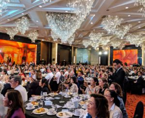 The room filled quickly - gold ticket holders sat at large tables while silver ticket holders sat in theatre style rows.