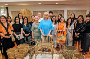 "Our day started with a look at some interesting and beautiful rattan products. I was very interested in learning more about rattan during this trip. Designers from across the Philippines gathered for a mini ""trade show"". Here I am with the group of designers and Department of Tourism Secretary Berna Romulo Puyat."