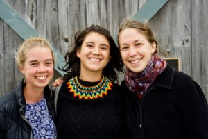 "Students Rayna Joyce '20, Ana Maria Zabala '20, and Indigo Woods '21 are this year's program coordinators. With ""Harvest Sunset""-fisted guests in tow, they led farm tours of Beech Hill and also stewarded the program and the fundraising event. It will be their job to pass along the torch to younger COA students."