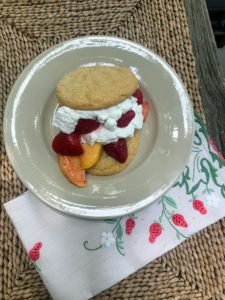 Many made their own shortcakes with cookies, whipped cream, strawberries, and peaches.