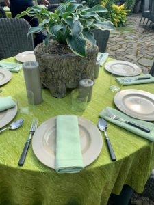 We used my drabware plates and adorned each table with faux bois planters filled with hostas from Surry Gardens. Flameless candles in Bedford gray from my collection at QVC surrounded each centerpiece planting. After the event, all the hostas are planted in the gardens.
