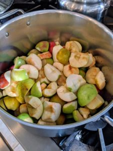 And then sets the pot over medium to high heat just until they start to cook. And, guess what? That is all you need - you don't need any sugar at all. The apples will start to cook right away.