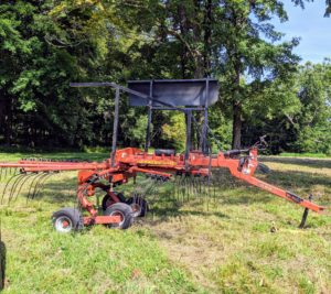 After the hay is tedded and dried, it is then raked. Raking the hay is easily the fastest part of the process. The rake is used to create more windrows that the baler can pick up.