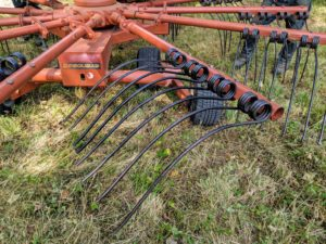 This is a rotary raker. It lifts and sifts the hay, but also helps loosely pile the hay to prepare it for baling.