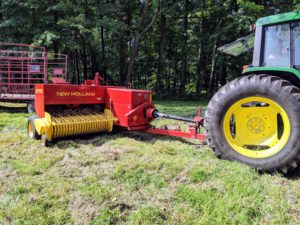 A baler is a piece of farm machinery used to compress a cut and raked crop into compact bales that are easy to handle, transport, and store.