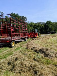 "Behind the baler is the hay trailer, which will be used to catch the ""square"" bales once they are formed and tied."