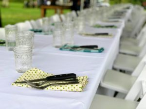 Though under a tent, we kept to the format of a beautiful, long table with linens. Mason jars held our wine and water. I wasn't sure if Martha would have approved of the utensils all on the napkins like this, but we needed them for weight against the wind!